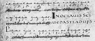 Arras, Bibl. mun., ms. 686, f. 87. Office monastique de l'Octave de saint Vaast. La notation neumatique est surmontée des voyelles du texte.